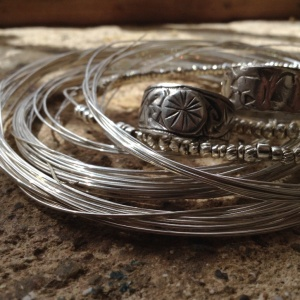 Still need to write this post... CC: pile of silver wire and vintage Moroccan rings.